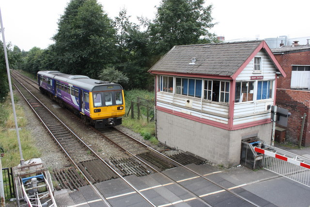 Class 142 train and Shaw Station Signal Box