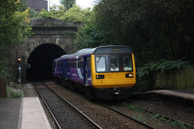Class 142 train emerges from tunnel at Oldham Werneth