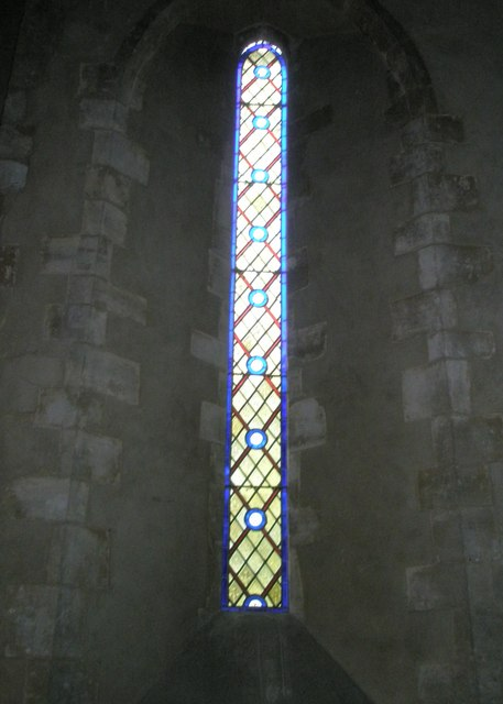 Simple stained glass window on the north wall at St Michael, Chalton
