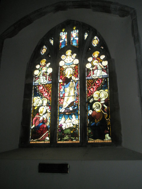 Stained glass window on the south wall at All Saints, East Meon