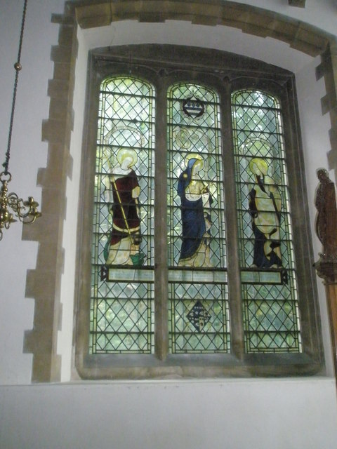 Stained glass window in the chancel at All Saints, East Meon