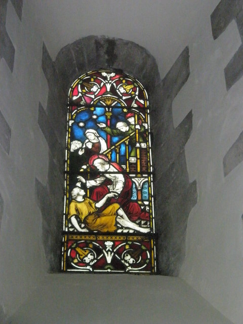 Stained glass window above the organ at All Saints, East Meon