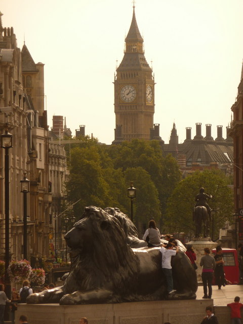 London: one of Trafalgar Square's lions and Big Ben