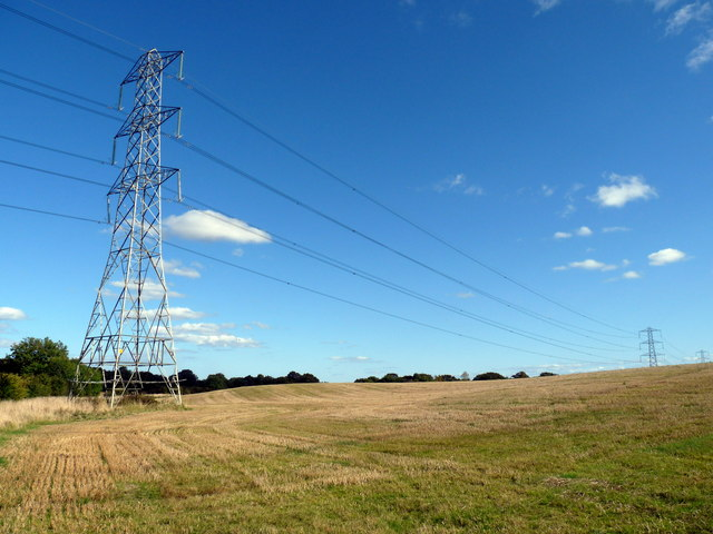 Looking past pylons to Flat Wood