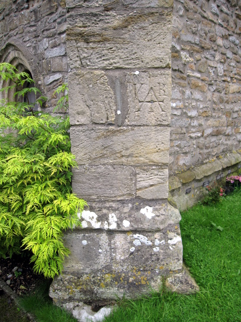 Bench mark on St Oswald's, Thornton in Lonsdale