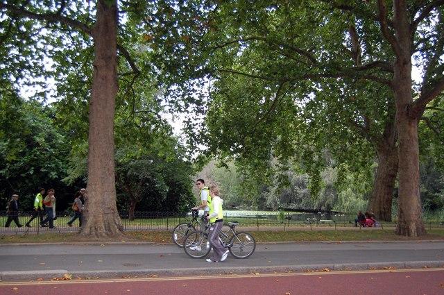 Cyclists passing St James's Park
