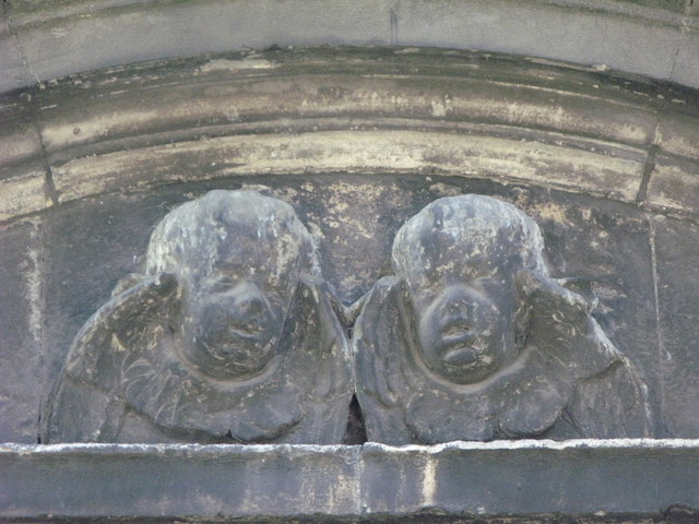 St. Nicholas' Church, Deptford Green, SE8 - putti (sadly not pretty) above the north door