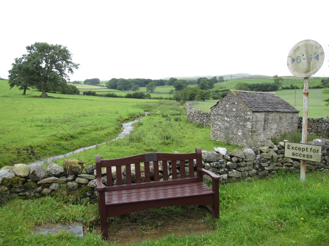A bench, stream and barn at Thornton in Lonsdale