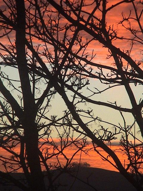 Dawn over round hill
