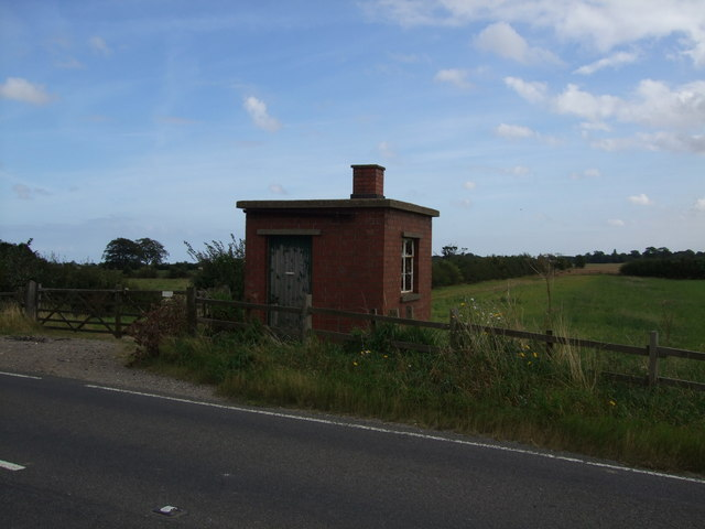 Railway workers hut aside B1200 and trackbed