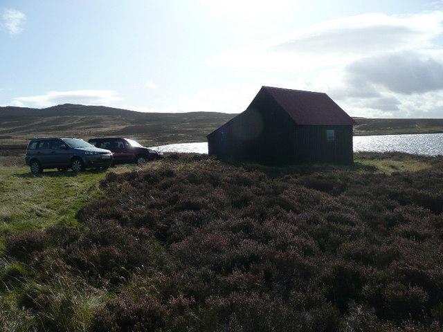 Fishermen's cars and hut at Loch Broom