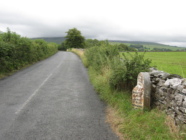 View towards Ingleborough and a milepost
