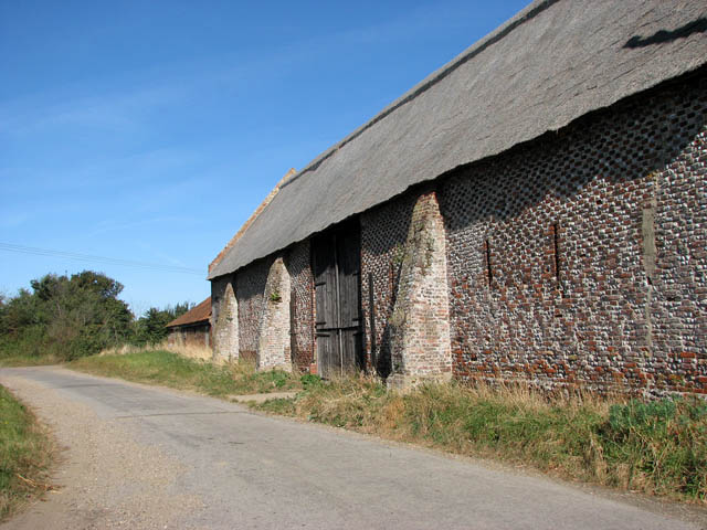 Old flint and brick barn by Manor House Farm