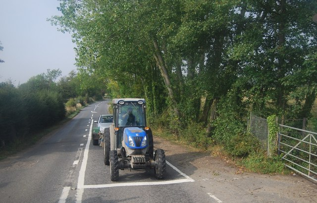 Tractor waiting at a level crossing, Beltring