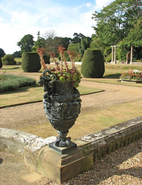 Somerleyton Hall - planted urn by steps to front lawn