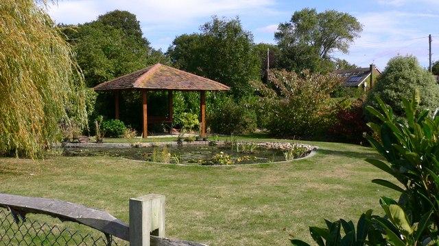 Pretty garden pond by footpath on Hayling Island