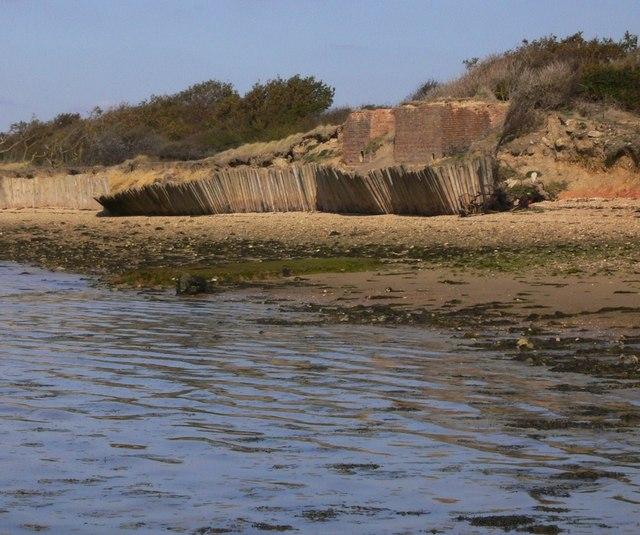 Fence on shoreline on Hayling Island