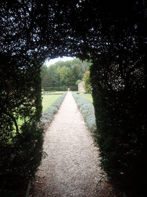 Pathway alongside the walled garden