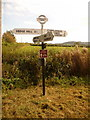 ST8427 : Motcombe: North End Cross signpost by Chris Downer