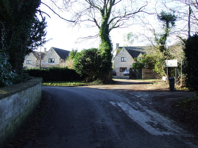 Road into Cowley with the Rectory on the left.