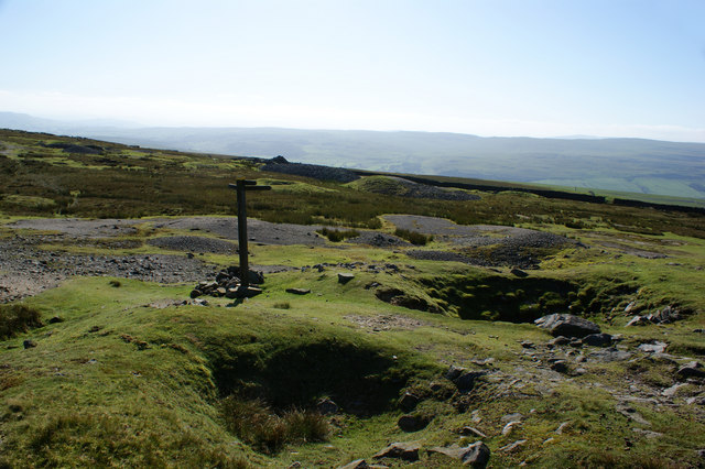 A finger post among the spoilage of old mine workings