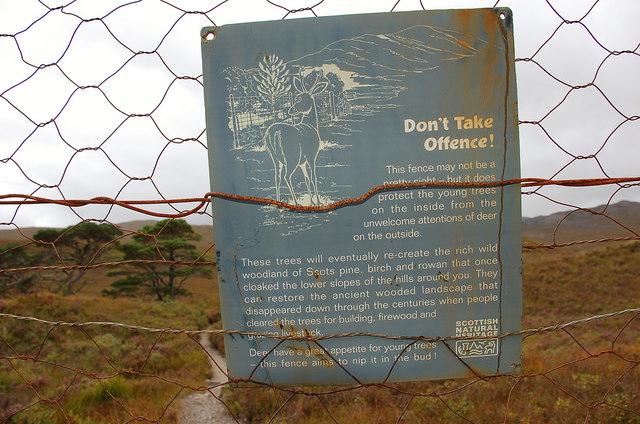Deer fence notice in closeup