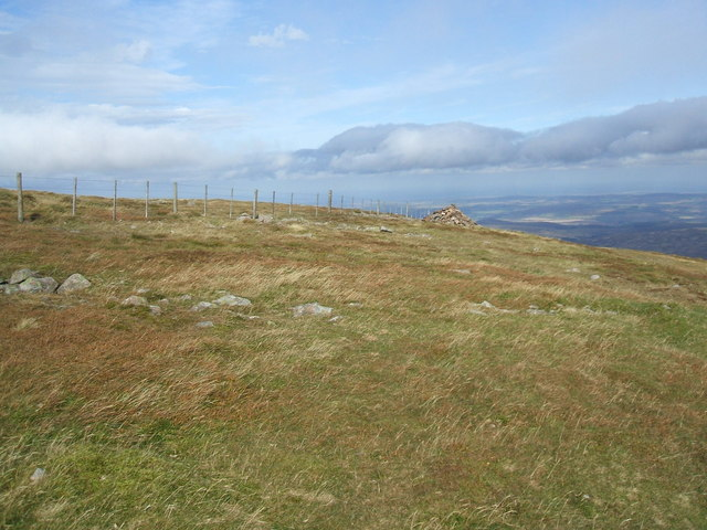 Fence and cairn on The Cheviot