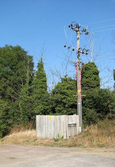 A busy-looking electricity pole