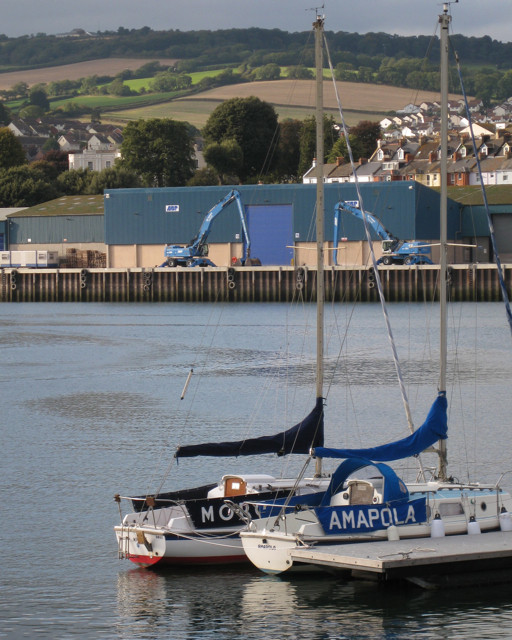 Two yachts, two cranes, Teignmouth harbour