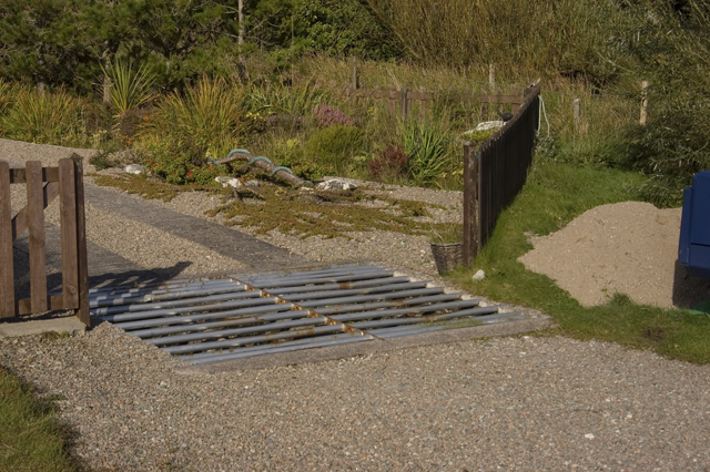 Cottage entrance and cattle grid Orasaigh