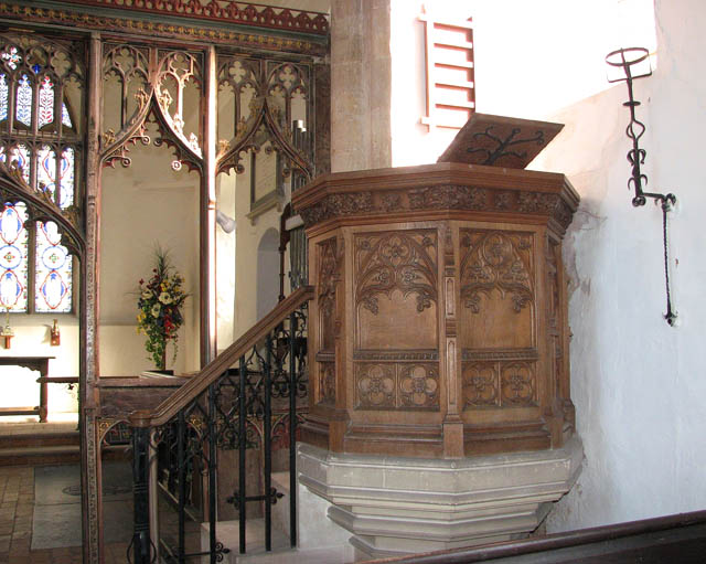 The church of All Saints - pulpit and hourglass stand