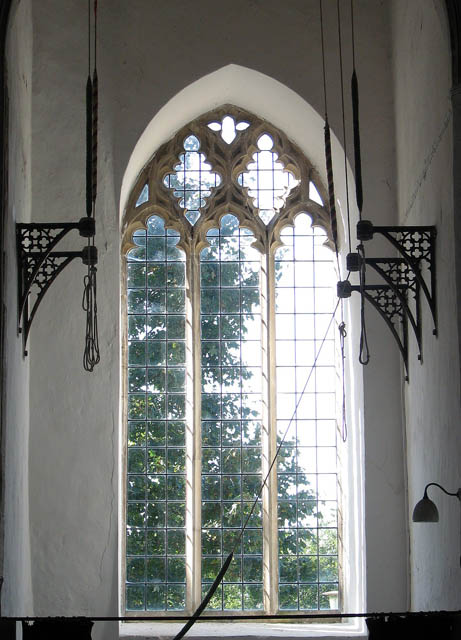 The church of All Saints - west window with bell ropes