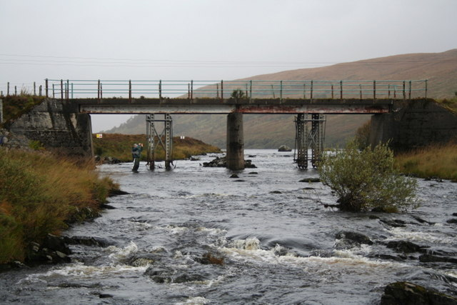 Playing a trout by the bridge on Loch a' Ghriama burn