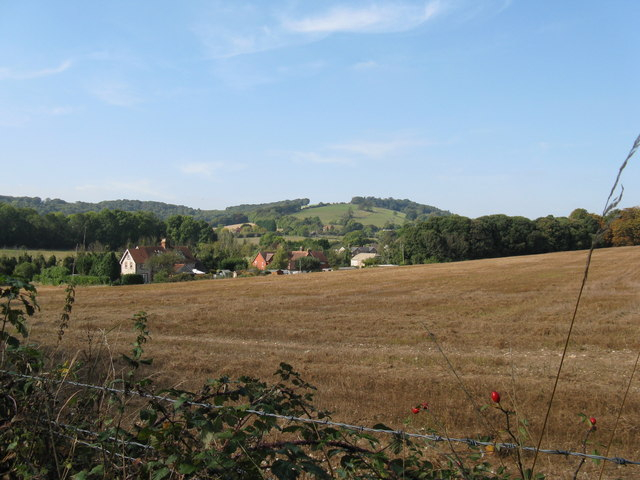 View across field to property on the A 24