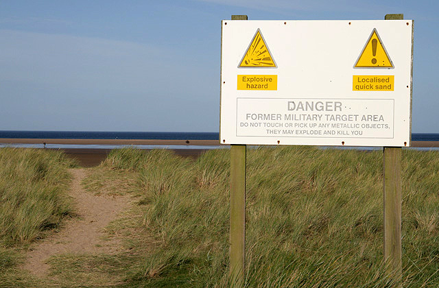 A sign at Goswick Links