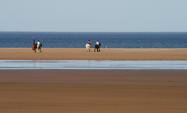 Horse riders on Goswick Sands