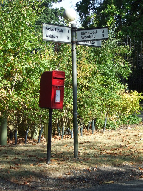 Postbox And Road Sign