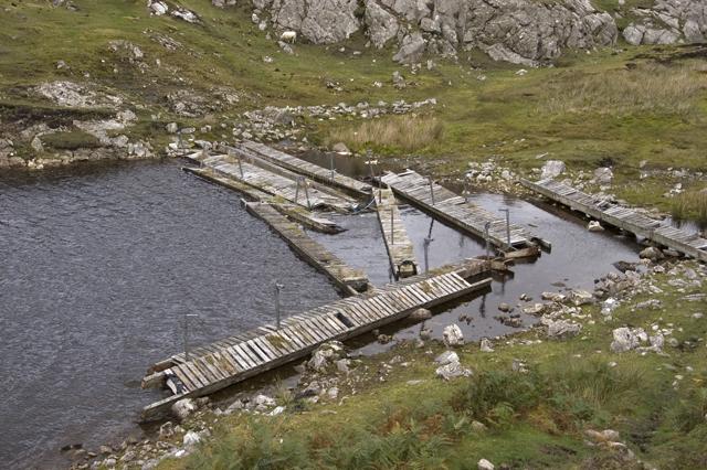 Wreckage of a fish farm in Loch an Duin