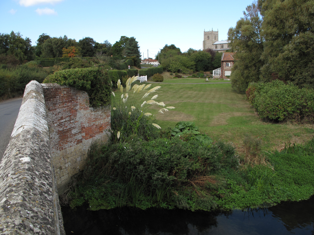 Wiveton village and church from the bridge on the River Glaven