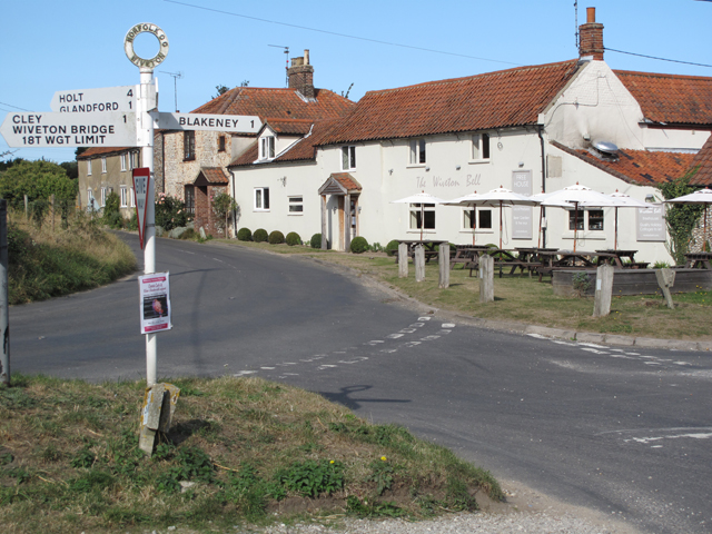 The Wiveton Bell pub and signpost