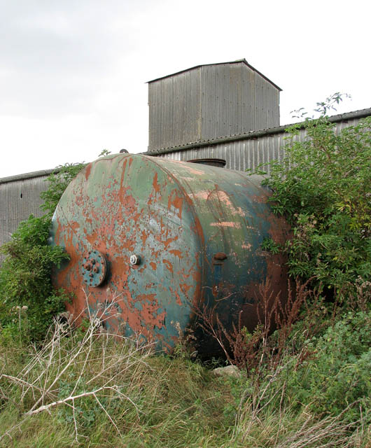 Tank protruding from farm shed