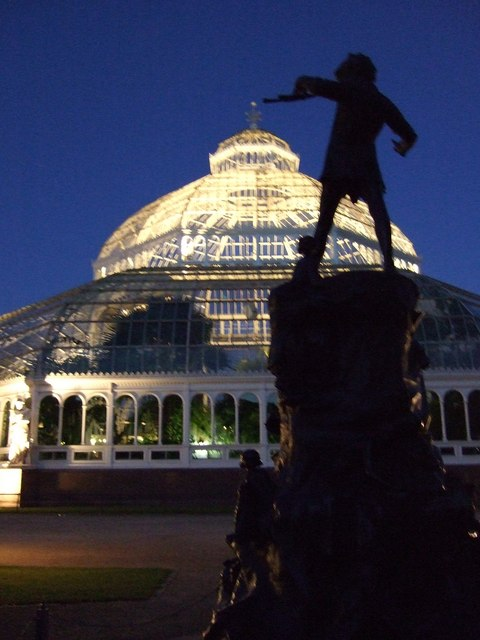 Palm House and Peter Pan Statue at night.