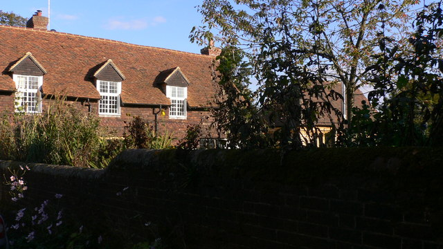 The farmhouse at Hall Place Farm seen from bridleway