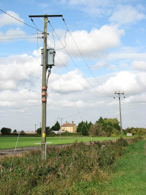 Electricity poles beside the A1101 (Mildenhall Road)
