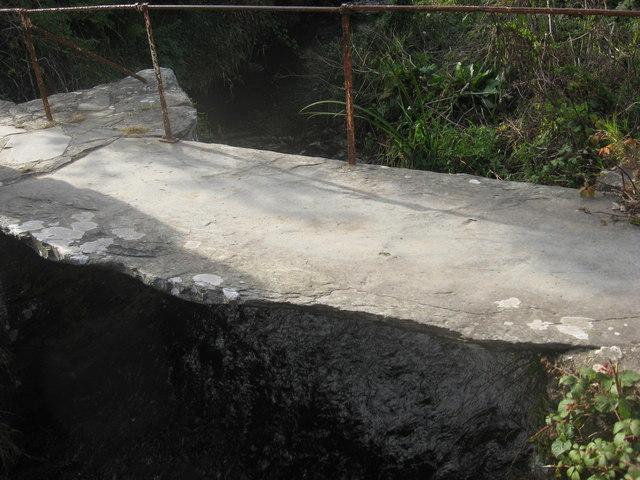 Monolithic slate bridge over the River Alun at Porth Clais