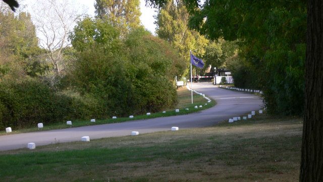 Mill Rythe driveway with flag and barrier