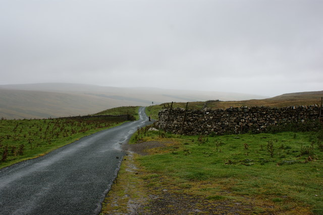 The road over North Moor by the cattle grid