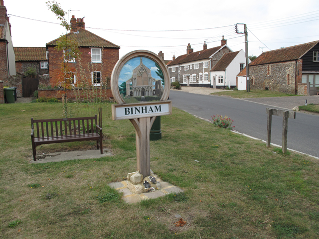 Village sign in the middle of Binham