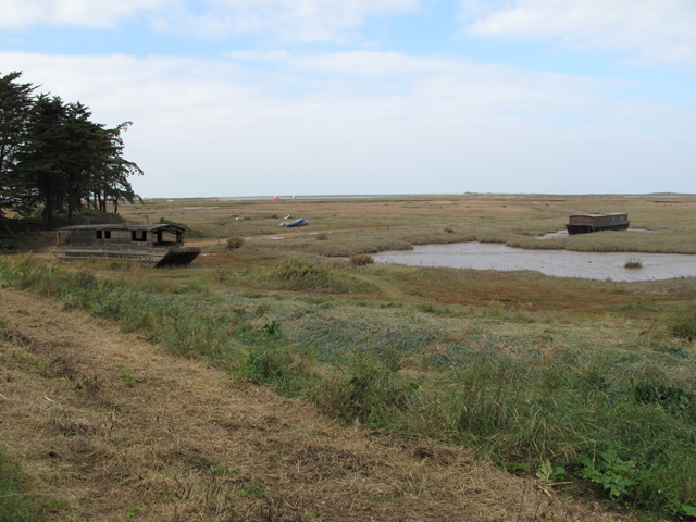 Marshland and old boats at Burnham Deepdale