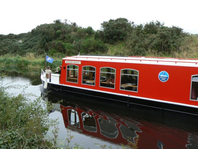 Canal boat heading east, near Glasgow bridge